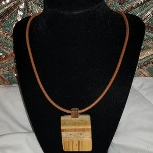 Wooden pendant with faux leather necklace.